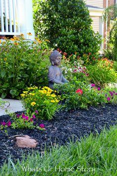 Create a calming zen vibe to your garden by adding a Buddha statue - zen garden