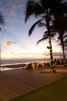 Enjoy a romantic dinner overlooking the sunset views across the beach