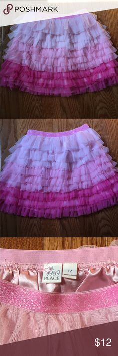 Pink Glittery Skirt This pink glittery skirt has sparkles/glitter on the elastic waistband. The skirt has different shades of pink. This skirt has no shorts underneath, it is not a skort. Size M/12. The material of the different shades of pink of the skort is a lace type of fabric. NEVER WORN. 1st pic shows front, 2nd pic shows back of skirt. Children's Place Bottoms Casual