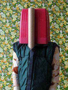 Thorsten Brinkmann: Post-Dada-Objet-Trouvé Portraits   rebel:art... Plug type costume with some work.  Like the cardboard tubes