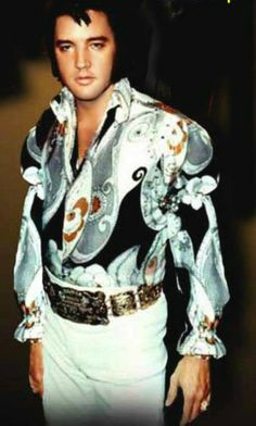 ELVIS - He wore some of the most colorful clothing and everything that he wore looked good on him.