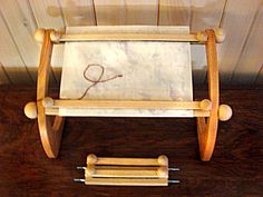 The Dutch Treat Frame with clamps. Love working with paper? This frame is perfect for that. The sidebars have 4 sets of holes to work many sizes of stitching projects.   doodlinarounddesign.com $60.95 (clamps sold separately)