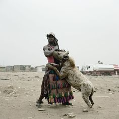 Pieter Hugo  http://the-chemistry.net/wp-content/uploads/2013/10/1361717934_abdullahi-mohammed-with-mai1.jpeg #PieterHugo #africa #hyena #man #portrait #photography #photograph #southafrica