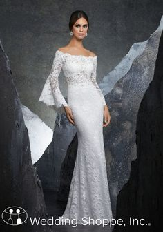 "Mori Lee ""Kiersten"" features romantic lace, delicate bead work, and a boho chic look that is sure to make a statement. Long sleeves and a lace off the shoulder look complete this beaufiul dress 