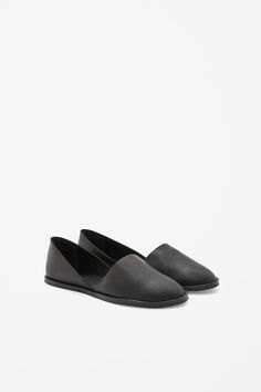 An easy slip-on style, these flat shoes are made from smooth leather with raw-cut edges. Cut out on each side, they have anti-slip rubber soles and a leather insole for comfort.