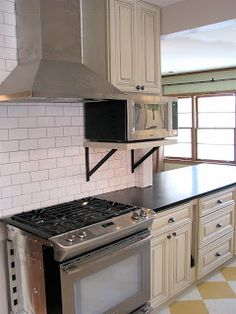 Makin it in Memphis: Kitchen Renovation: The Reveal. Like the subway tile and the microwave on the shelf Kitchen Dinning Room, Home Decor Kitchen, Home Kitchens, Kitchen Design, Kitchen Ideas, Modern Kitchen Cabinets, Kitchen Shelves, Kitchen Storage, Flat Interior