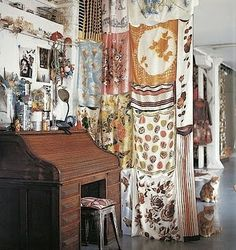I want to do something like this with vintage linens to hide my washer and dryer.