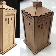 """The pieces of this corrugated cardboard model of Doctor Who's TARDIS were cut out using a laser cutter and assembled using a minimal amount of glue. Don't have a laser cutter? The parts may be printed on paper, glued to cardboard, then cut out by hand. The template for the TARDIS is available at the DIY website, Thingiverse."""