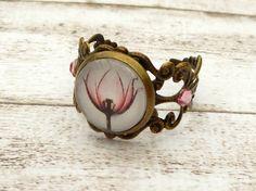 Filigraner Ring mit zarter Blüte in bronze rosa von Schmucktruhe