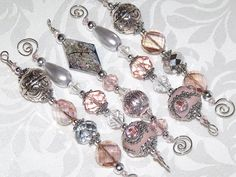Gorgeous combination of pale pink, peach, silver, clear and gray in a fun mix of clay, glass, crystal, acrylic and metal beads - three different