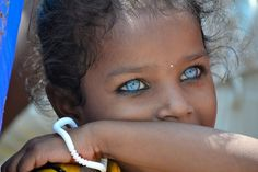 This photo is actually of a Melanesian girl, whose rare DNA unique to Melanesians gives her blue eys despite her deep skin & hair color. Description from pinterest.com. I searched for this on bing.com/images