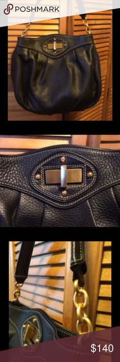 """MAXX NY Black Peebles Leather Purse Gorgeous black leather purse beautiful brushed goldtone hardware, great cloth lining with a leather trim zippered pocket on one side and a snapped leather pocket on the other side. 15"""" wide X 13"""" tall X 4 1/2"""" wide bottom. Used twice. I have about 8 black purses and forgot I had this one. I guess I really didn't need it. Maxx New York Bags Shoulder Bags"""