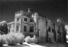 """Shute Barton Manor, Devon - is haunted by a gray lady. Some believe that she's the ghost of Lady Jane Grey, who is also known as the """"nine day queen"""", while others believe she is a member of the de la Pole family, who lived there during the Civil War. According to legend, Parliamentarians ambushed the woman as she walked through a grove near the house and hung her from one of the trees. Witnesses say she doesn't like to be approached and gives an admonishing stare before vanishing into thin air."""