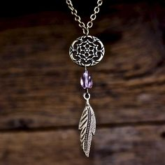 Bohemian - Dream Catcher - Necklace Antique bronze. Metal dream catcher & feather charm with glass purple bead between. Approximately 80 cm long! Beautiful hand made necklace! ❌TRADES❌ Jewelry Necklaces