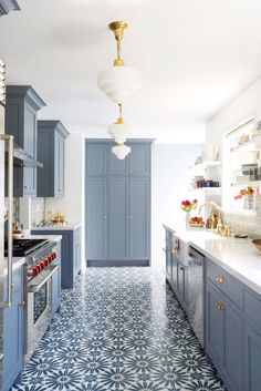 Blue-Gray Kitchen Cabinets.... the brass light fixture and cabinets hardware bring warmth to the space.