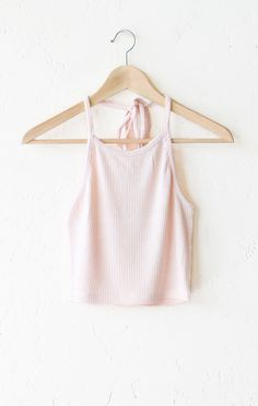 - Description Details: Super soft ribbed halter crop top in light pink with open straight cut back & adjustable self-tie around the neck. Form fitting, tend to run on the smaller side & are more fitte