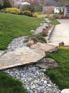 25 Gorgeous Dry Creek Bed DesignIdeas - Style Estate -Stone bridge and stairs across a dry riverbed