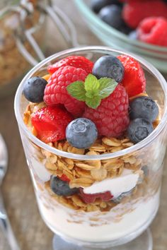 Delicious gluten-free granola pairs perfectly with fresh berries and Greek yogurt to create simple breakfast.