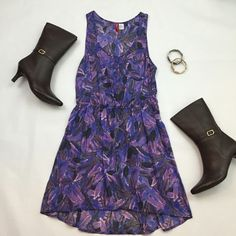 H&M High-low Feather Dress Too cute!  Purple high-low feather dress from H&M. Scoop neck with 4 purple buttons down the front and one on a small front pocket. 100% cotton. Light and summery material. Size 10 but H&M runs a bit small so more like a size 8. (Brown leather boots also available). H&M Dresses High Low