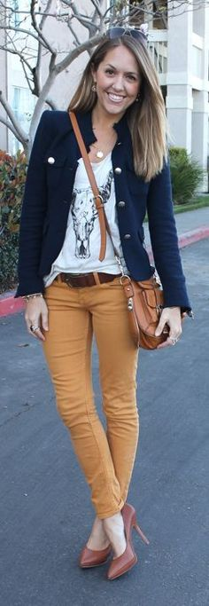 Wearing a graphic tee with a navy blazer & colored pants. Have navy blazer…
