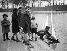 Sefton Park boating lake, 1950s - Shoes & socks on the bank as we wading out to retrieve to boats that got stuck.