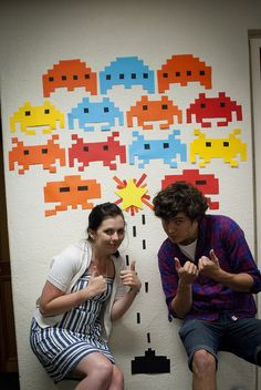 @Heather Steinbach perfect gaming room decor!! Classic video games murals on each wall!! Loves it!