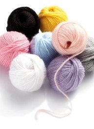 Set of 8 little balls of pastel-coloured yarn