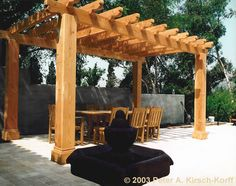 Mission Style Wood Dining Pergola - Los Angeles, California 1998, Douglas Fir, 10'x20'x10'. High End Pergola: $15,000 - $20,000 (Seriously!? Holy cow!)