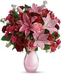 DH's Roses and Pearls Bouquet Flowers - Shell be delighted when she receives this gorgeous array of roses, lilies and more artistically arranged in a dazzling pink reflections vase.