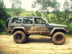 "Not really a truck but the mud, I couldnt resist. *drool*  ""Jeep Cherokee XJ muddy from offroading"""