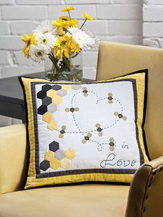 "Make a pillow with simple piecing and then embellish it with English paper-pieced accents. The combination makes a stunning finished pillow. This e-pattern was originally published in the February 2013 issue of Quilter's World magazine. Size: 16 3/4"" x 16 3/4"". Skill Level: Intermediate"