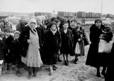 Birkenau, Poland, Women and children after the selection walking towards the gas chambers. This is the last few hours of life. May 1944