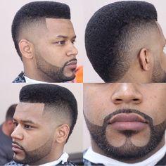 Clean fade...w/ his beard lookin' like perfection!!