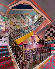 This colourful hallway and staircase always stops me in my tracks