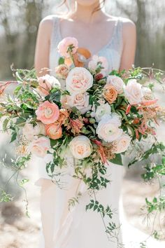 Blush + peach bridal bouquest with ranunculus, garden roses and jasmine