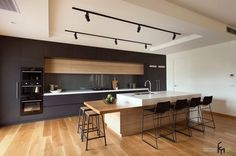 A Gorgeous Kitchen Design With Black Wooden Kitchen Cabinet Also Marble Backsplash With Marble Countertop Plus Modern Metal Bar Stools Gorgeous Kitchen Trend Design 2015 in Modern Interior Style Kitchen design