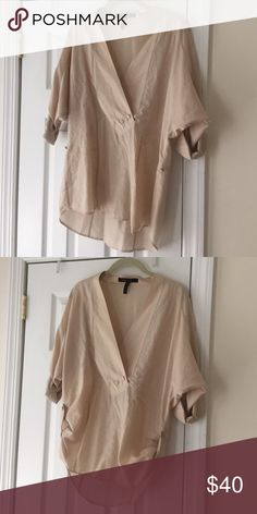 Beige BCBG top Lightweight beige BCBG top with adjustable length. Cotton/silk blend. Dry clean only. BCBGMaxAzria Tops Blouses