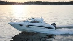 With the Yamarin 68 Cabin, you can begin the boating season right after the thaw and continue until the water freezes, travelling comfortably inside the cabin. Power Ranges, Mug Holder, Septic Tank, Boater, Power Boats, Ds, Yamaha, Remote, Solar