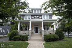 Arlington dream house. Love the stone porch railings with the cutouts.