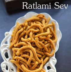Popular Ratlami Sev from Ratlam region. Spicy, crunchy, flavorful with variety of spices this sev makes great tea time or Diwali snacks Indian Desserts, Indian Sweets, Indian Snacks, Indian Dishes, Indian Food Recipes, Indian Foods, Savory Snacks, Snacks Recipes, My Recipes