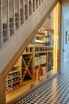 Palewell Park Richmond West London. Bespoke Under Staircase Wine Storage by Newton Barnes