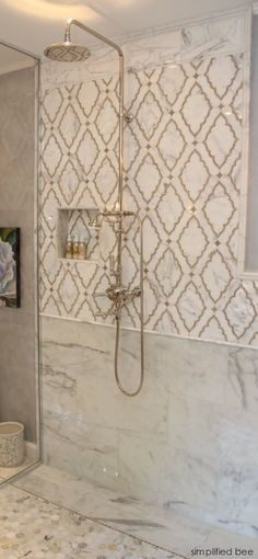 A marble mosaic backsplash. This is absolutely gorgeous for the shower. Bathroom design inspiration.