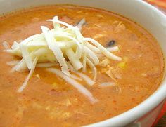 Delicious! chicken enchalada soup. 20 oz green enchalada sauce, 1 minced onion, 1 red bell pepper diced, 2 cans cream chicken soup, 1 can diced tomatoes, 2 cans black or pinto beans, 1 can corn, 3 cups milk, 1-2 lbs shredded chicken. Add all to pot and cook 15 mins. Add 1/2 cup chopped cilantro at end. Top with tortilla strips and cheese if desired. A squeeze of lime juice is also good.