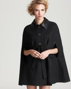 black cape with leather collar and tie #fall2012  Always on the fence about this, but this year I am getting one! For more amazing style inspirations visit http://www.styleontheside.com #coats