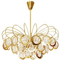Italian Sciolari Style Chandelier, Glass and Brass, 1960s | See more antique and modern Chandeliers and Pendants at https://www.1stdibs.com/furniture/lighting/chandeliers-pendant-lights