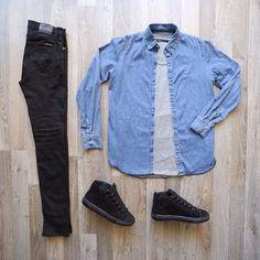 Faded denim shirt; black slim-fit jeans; black hi-top sneakers