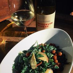 Enjoy an evening glass of wine with our kale salad, with sliced apples, grilled scallions, lemon tahini and crispy cumin chickpeas!