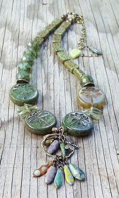 dragon fly beads at bottom?  can I use polyclay to make?
