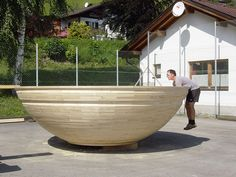The largest turned wooden bowl measured 4.01 m (13.15 ft) in diameter and 1.03 m (3.37 ft) from base to rim. The bowl was made by Peter Andres and Werner Rumplmayr in Gurtis, Austria on 4 September 2005. The enormous cost of a giant lathe brought the idea to use a tractor as woodturninglathe.  D