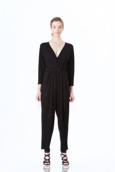 High-waisted black cotton jumpsuit with flare legs by Kali